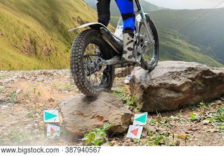Trials  Motorcycle  Is Jumping Over Rocks In Race