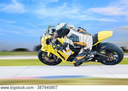 Motorcycle Leaning Into A Fast Corner On Highway