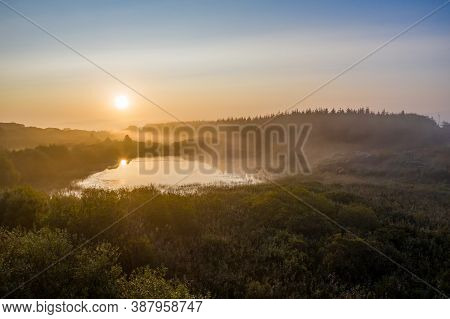 Sunrise Over A Peatbog In County Donegal - Ireland.