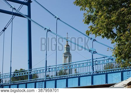 Cable-stayed Pedestrian Bridge In Tambov Through Which The Bell Tower Is Visible