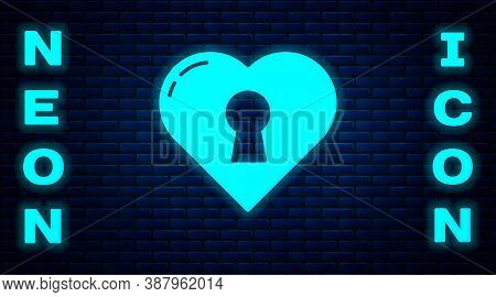 Glowing Neon Heart With Keyhole Icon Isolated On Brick Wall Background. Locked Heart. Love Symbol An