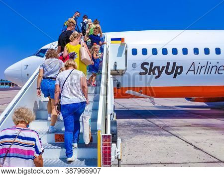 Sharm El Sheikh, Egypt - September 15, 2020: People Going At Skyup Airlines Boeing 737-800 Aircraft