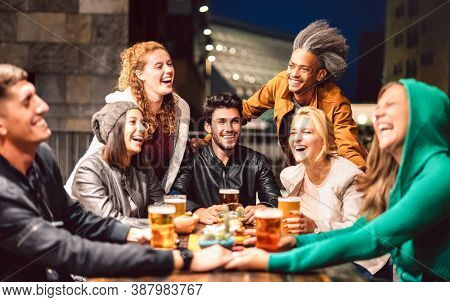 Happy People Drinking Beer At Brewery Bar Out Doors - Friendship Lifestyle Concept With Young Friend