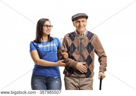 Young volunteer helping an elderly man with a cane isolated on white background