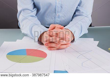 Sales Manager Working At Modern Office. Business Woman Holding Her Hands Clasped. Business Documents