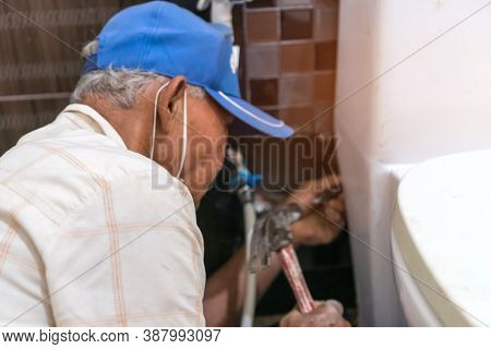 Technician Asian Elderly Plumber Repairing Broken Water Pipes In Bathroom, Worker  Builder, Repairma