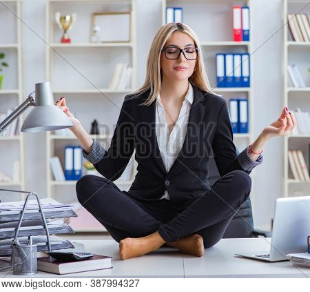 Businesswoman frustrated meditating in the office