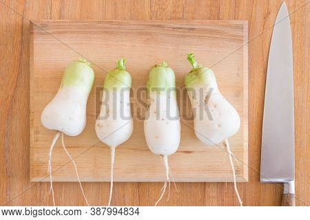 Homegrown Mooli Radish (daikon) Roots On A Chopping Board And Kitchen Table In Uk. Flat Lay Food Ing