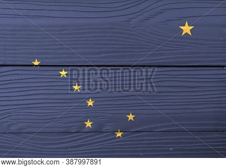 Flag Of Alaska On Wooden Wall Background. Grunge Alaska Flag Texture, State Of America. Eight Gold S