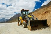 wheel loader excavator machine doing ready to earthmoving roadwork at india mountains poster