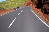 Canary Islands winding road curves in red mountain poster