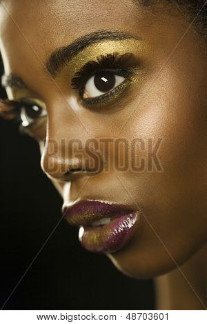 Closeup portrait of an African American woman with highfashion makeup