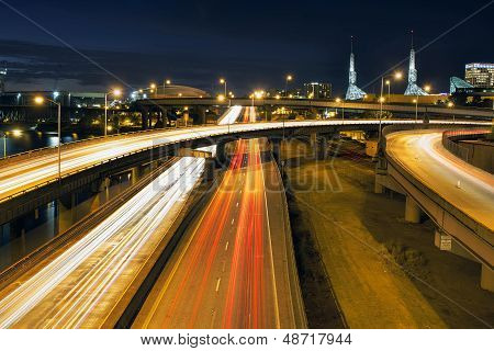 Interstate Freeway Light Trails Through Portland Oregon City Along Willamette River at Blue Hour poster