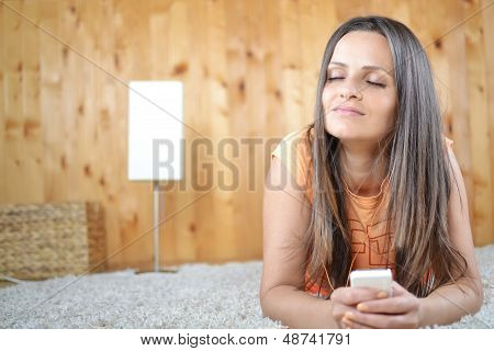 A beautiful young girl laying in her room
