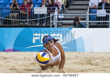 12/08/2011 LONDON, ENGLAND,  Mayra Garcia (MEX) dives for the ball during the FIVB International Beach Volleyball tournament, at Horse Guards Parade, Westminster, London.