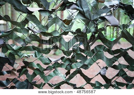 Background with the image of a camouflage net