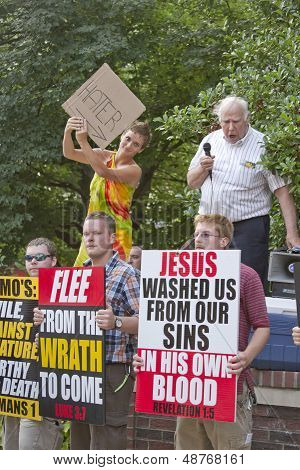 People Protesting Each Others Conflicting Relgious Befiefs At The Bele Chere Festival In Asheville,