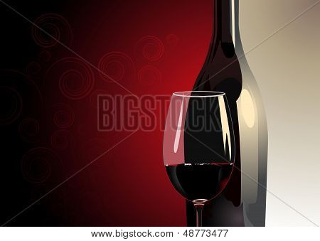 Glass of red wine with a bottle