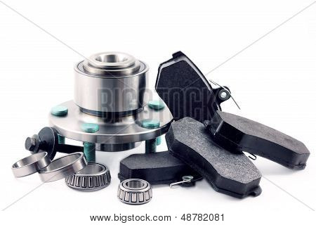 Spare parts for cars on a white background hub brake pads bearing and bolt. poster
