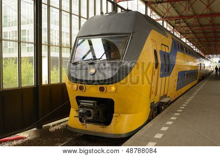 EINDHOVEN, NETHERLANDS - JUNE 23: Regional train arrives on the train station of Eindhoven, Netherlands on June 23, 2013. Dutch trains are punctual with 94% (2012) of train services labeled