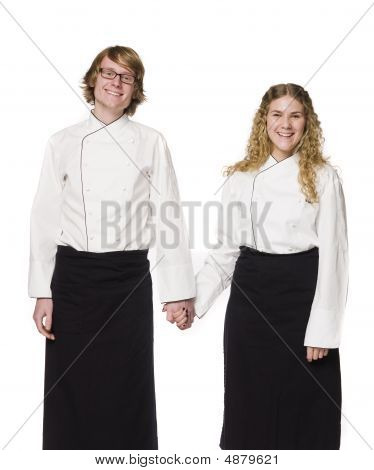 Waiter and a waitress holding hands
