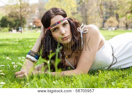 Pretty Young Woman In A Headband Daydreaming