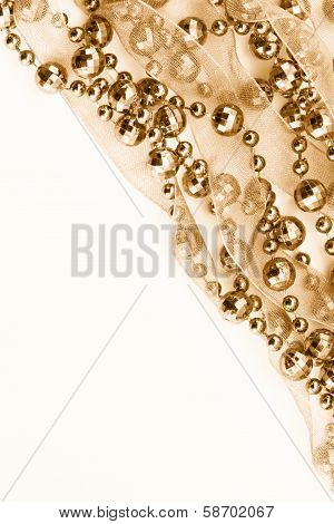Close up of golden garland. Light background. poster