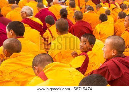KHATMANDU, NEPAL - DEC 17: Unidentified tibetan Buddhist monks near stupa Boudhanath during festive Puja of H.H. Drubwang Padma Norbu Rinpoche's reincarnation's, Dec 17, 2013 in Khatmandu, Nepal.