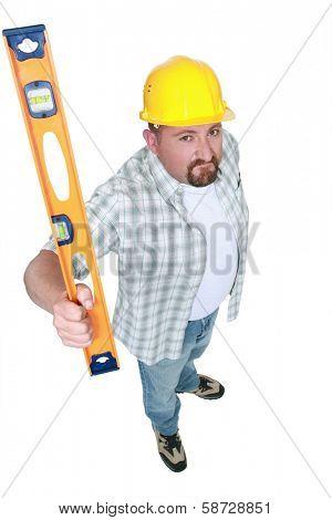 Builder brandishing a spirit level
