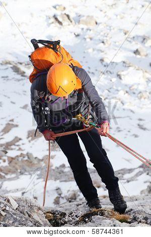 Alpinist climbing ferrata La torre di Toblin (2.617 m), Dolomites, Italy, Europe poster