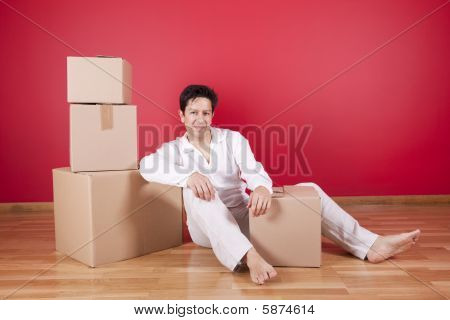Young Men Resting Next To Cardboard Boxes