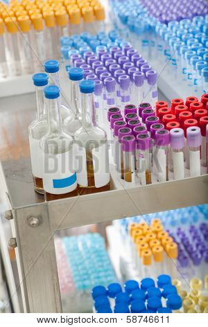Test tubes and bottles arranged on medical trolley
