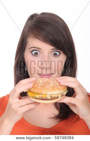 Brunette girl eating Burger poster