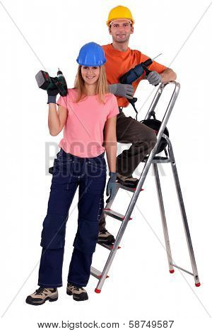 Couple of workers with power drills