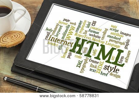 html (hypertext markup language) word cloud on a digital tablet with a cup of coffee