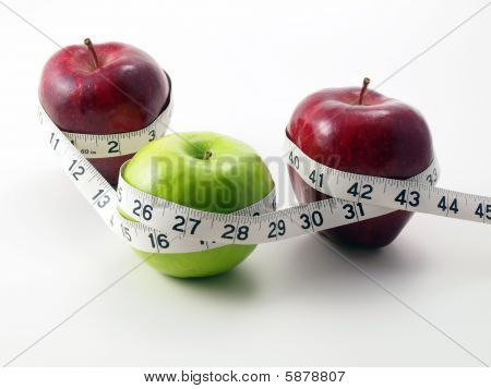 3 Apples Surrounded With Measuring Tape