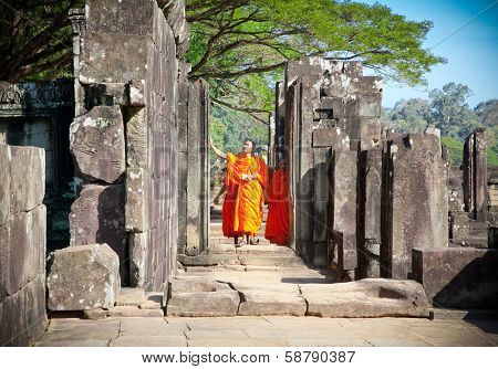 ANGKOR WAT, CAMBODIA - NOV 21,2013: Buddhist monks in Angkor Wat complex on Nov 21, 2013.Cambodia. Angkor Wat was first a Hindu, then subsequently, a Buddhist temple complex in Cambodia.