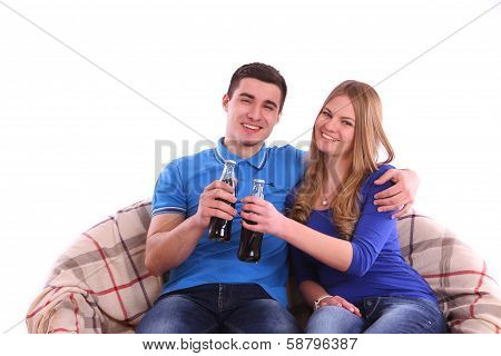 Young People Sitting On A Sofa And Drinking