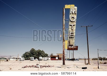 Hotel sign ruin along historic Route 66 in the middle of California's vast Mojave desert. poster
