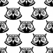 Black and white seamless pattern of wise owl heads with big eyes looking directly at the viewer, vector illustration poster