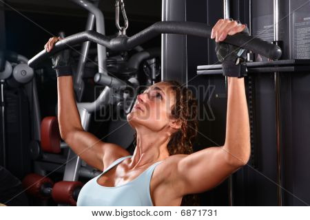 Bodybuilding woman exercising at the gym