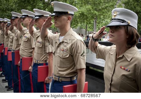 NEW YORK - MAY 23, 2014: U.S. Marines salute during the re-enlistment and promotion ceremony at the National September 11 Memorial site.