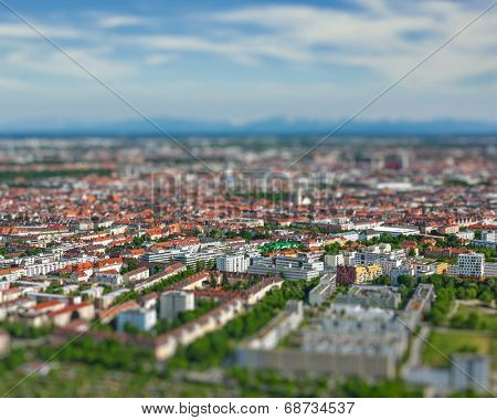 Aerial view of Munich from Olympiaturm (Olympic Tower). Munich, Bavaria, Germany with tilt shift toy effect shallow depth of field