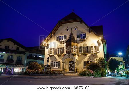 Statue Of Mozart And Townhall At Night In St. Gilgen
