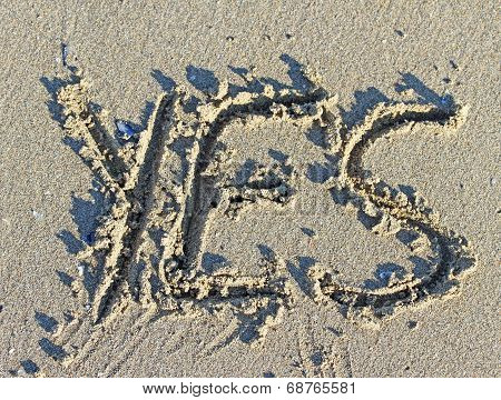 Great Written Yes Engraved On The Sand Of The Sea Beach