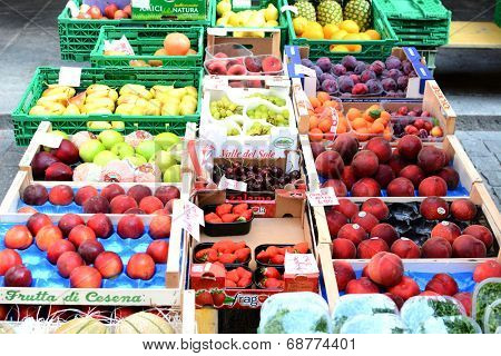BELLINZONA, SWITZERLAND - JULY 4, 2014: Fruit Stand Farmers Market Bellinzona. The Saturtay event takes over one of the main streets in Bellinzona once a week.