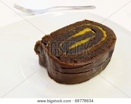 Chocolate And Custard Swiss Roll.