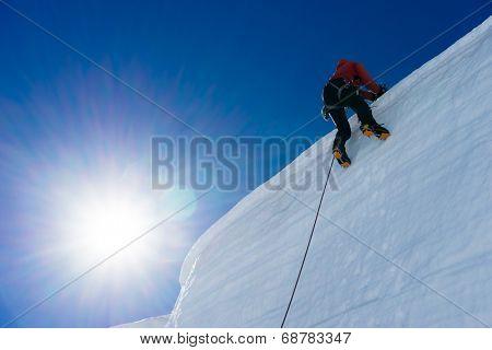 Low angle view of man climbing glacier