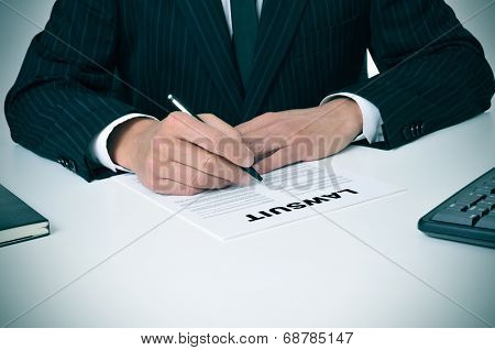 a lawyer in his office with a document with the text lawsuit written in it