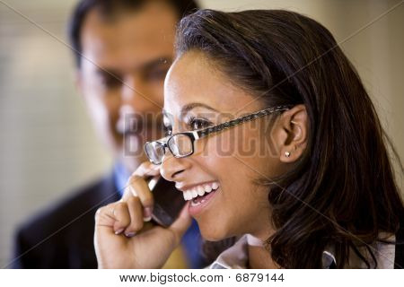 Young African-American woman talking on mobile phone
